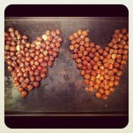 Two hazelnut hearts: one roasted and one raw