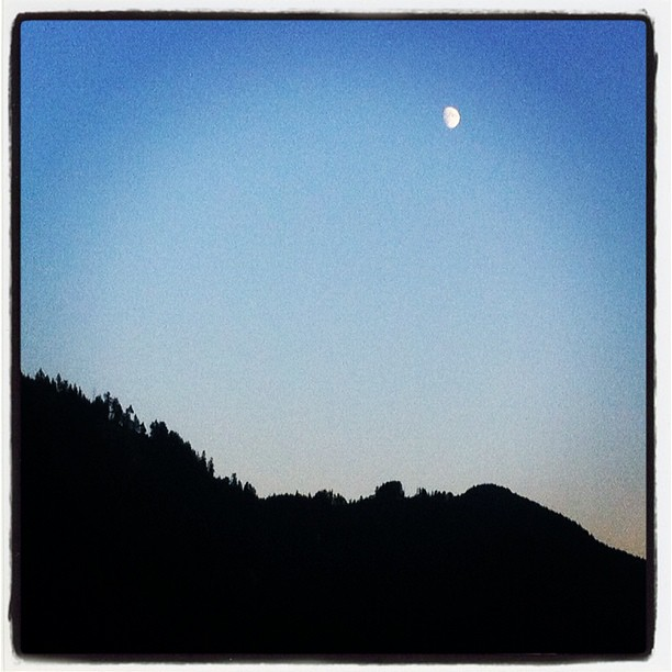 Half moon over the mountain at Pitt Lake