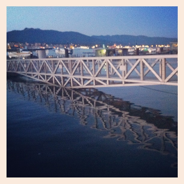Bridge reflection in the ocean's water close to Vancouver Harbour Water Airport