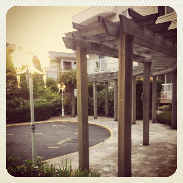 Nice Apartment Building Driveway And Wood Structure In